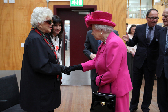 <p>The Queen is introduced to Dame Joan Plowright</p>