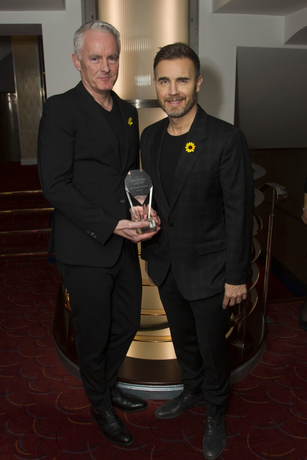 <p>Tim Firth and Gary Barlow accept the award for Best Regional Production for <em>The Girls</em></p><br />© Dan Wooller for WhatsOnStage
