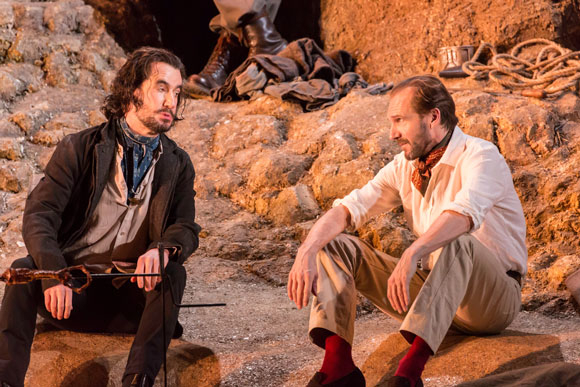 <p>Tim McMullan (Mendoza) and Ralph Fiennes (John Tanner)</p><br />© Johan Persson