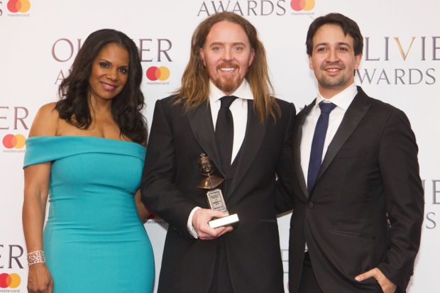 <p>Tim Minchin with the award for Best New Musical for <em>Groundhog Day</em> at the Old Vic, presented by Audra McDonald and Lin-Manuel Miranda</p><br />© Dan Wooller for WhatsOnStage