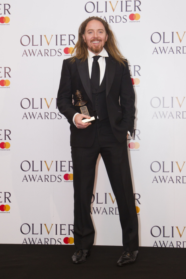 <p>Tim Minchin with the award for Best New Musical for <em>Groundhog Day</em> at the Old Vic</p><br />© Dan Wooller for WhatsOnStage