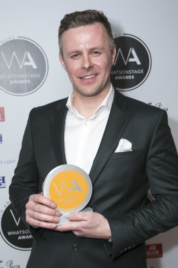 <p>Tom Lister accepts the award for Best Musical Revival for <em>42nd Street</em></p><br />© Dan Wooller for WhatsOnStage
