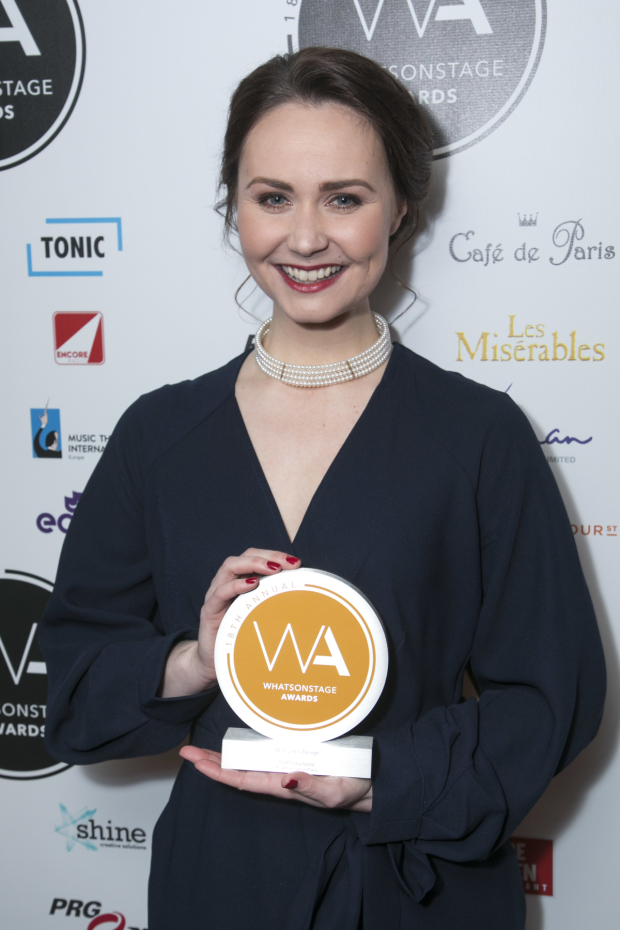 <p>Zoe Rainey accepts the award for Best Video Design for <em>An American in Paris</em> on behalf of 59 Productions